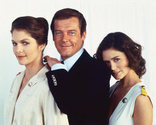 This is an image of 252068 Roger Moore,lois Chiles & Corinne Clery Photograph & Poster