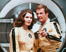 This is an image of 252064 Roger Moore & Lois Chiles Photograph & Poster
