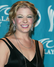 This is an image of 255562 Leann Rimes Photograph & Poster