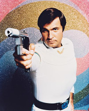 This is an image of 22340 Gil Gerard Photograph & Poster