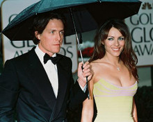 This is an image of 241287 Elizabeth Hurley & Hugh Grant Photograph & Poster