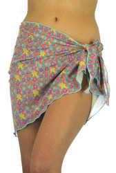 Orange sarong in Bubbles print -- tan through beachwear.