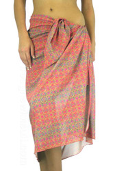 Pink Forever pareo in tan through fabric.