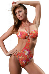 Aspen models fashionable tan through monokini in beautiful orange Art Nouveau print.