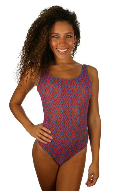 Tan through traditional tank swimsuit in blue Hibiscus print.