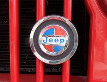 Grill emblem,  Reproduction grill emblem. Found on AMC era jeeps. Metal casting, chrome plated, raised letters, polished, painted to original colors.  Comes complete with mounting brac...