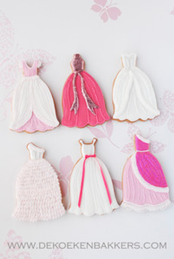 Decorated cookies that show each dress alteration if you use the cutter for cutting out the cookies.   Please view our other photos that show how to use the multi cutter to cut out just fondant.  This cutter works for any of our Cindy's Confection style dresses.