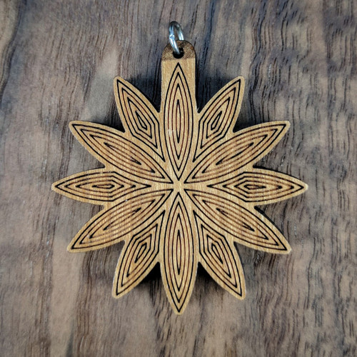 Seed Lotus Linework pendant on Cherry Hardwood