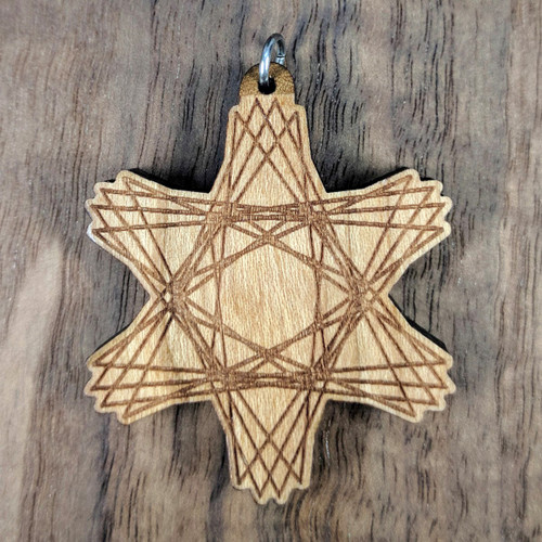 Cosmic Burst pendant on Cherry Hardwood