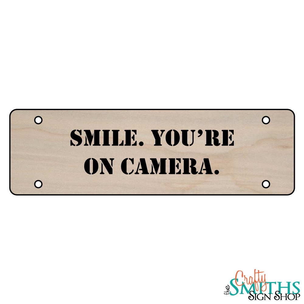 how to smile naturally for the camera
