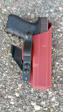 AIWB shown in Blood Red with Strut And Soft Loop,  Concealment Claw, and Body Side Only Sweat Guard