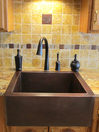 "25"" Hammered copper farmhouse sink installed as top mount"