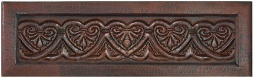 Farmhouse copper kitchen sink with heart design on apron front