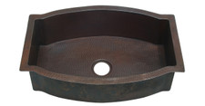 Large Hammerd copper kitchen sink with arched design