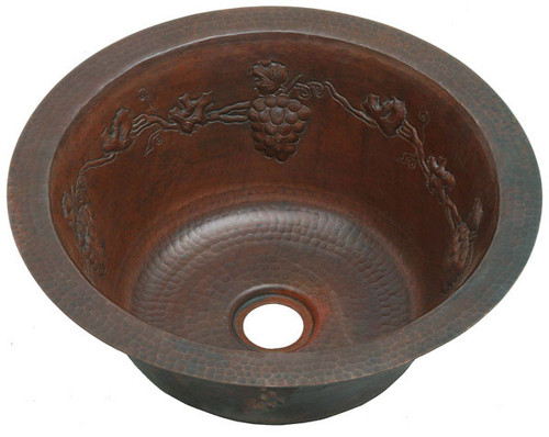 Round copper bar sink with grapevine design