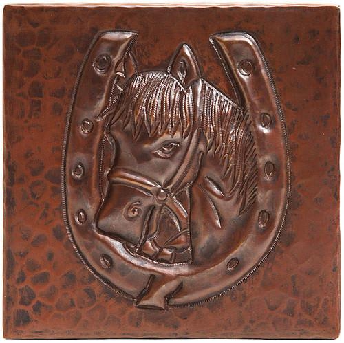 Horseshoe with horsehead design copper tile