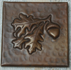 Hammered copper tile with acorn and leaves design