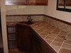 Hammered copper tiles in counter top and as back splash tile liners