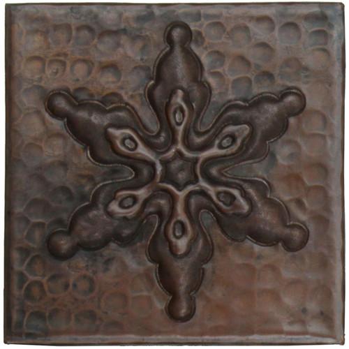 Ornamental snowflake design copper tile