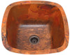 Hammered copper square bar sink in natural fire patina.