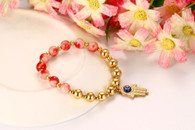 LUXE PINK CORAL GOLD BRACELET (HAMSA HAND)