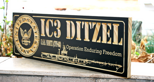 Military plaque with USS Nimitz