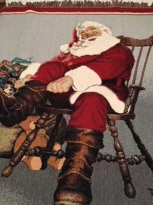 Christmas Santa pulling on winter boots for the holiday hours on his sled. Seasonal tapestry throw blanket