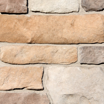 Picture of a Limestone Stone Veneer in the Alpine color palette by Superior Stone (Washington based). Pictured with lighter grout.
