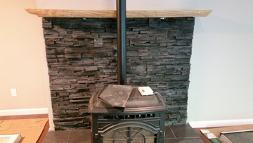"""NW Stacked Stone Kodiak. This fireplace is from a new construction job. This is a panelized product that comes in 4"""" x 20"""" panels. Easy to install and adds value to your home."""