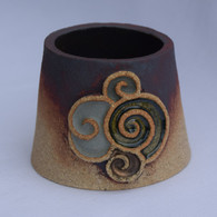 Spiral Tea Light Holder made from a stoneware clay, coloured glazes and oxide.
