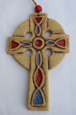 Celtic Cross Hanging made from a texture stoneware clay, coloured glazes and oxide. Hessian string and a bead added to hang.