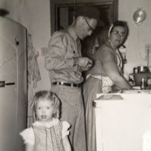 1950s kitchen with Grandma washing dishes in apron