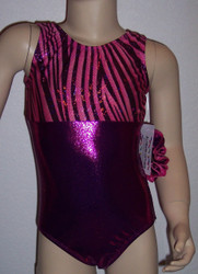 Gymnastics and/or dance leotard in a beautiful MAGENTA RIBBON spandex split with solid magenta mystique spandex.  Available in tank or racer back. Free scrunchie included.