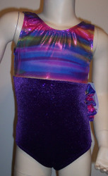 Adorable gymnastics leotard in a multi-colored purple metallic spandex split with purple sparkle velvet.  Available in tank or racer back.  Free scrunchie included as always.