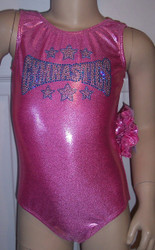 LIMITED QUANTITIES! Cute gymnastics and/or dance leotard in a PINK MYSTIQUE SPANDEX with beautiful & large gymnastics applique.  Available in tank or racer back. Free scrunchie as always!