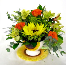 Sunflowers and accent flowers designed in a Sunflower Teacup by Chappell's Florist