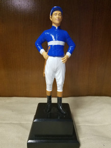 "9"" Jockey mounted on wood base painted black.  May also be customized to be used as a lamp, book end or door stop."