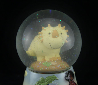 https://s3.amazonaws.com/zeckosimages/25589C-yellow-whimsical-dinosaur-water-snow-globe-1H.jpg