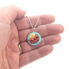 bacon and eggs necklace in hand, inedible jewelry