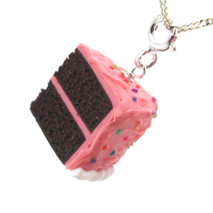 pink birthday chocolate cake slice necklace by inedible jewelry