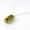 celery and peanut butter necklace by inedible jewelry