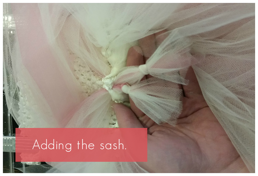 Adding a sash to a DIY flower girl tutu dress.