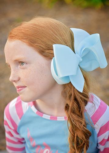 Light Blue Texas size hair bow with French clip for girls.