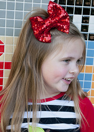 Red sequin hair bow for girls.
