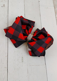 "Red and black buffalo plaid double looped hair bows. These alligator clip bows are approximately 7"" across."