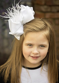 "A large double looped grosgrain ribbon hair bows with an ostrich feather puff the center.  Attaches with a large 3"" alligator clip with ""teeth"" for a secure hold.  The bow measures approximately 6.5"" long and 5"" wide."