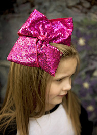 Our bestselling Texas size bows are now available with sequins! These sequin covered bows are approximately 7+ inches across and include an alligator clip backing. As with most sequin embellished items, some sequin loss is normal.