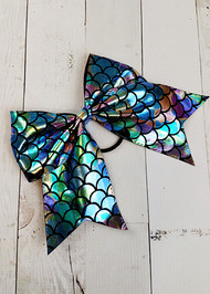 "Mermaid cheer bow in metallic rainbow fish scale pattern. Approximately 6"" across with 6"" tails."
