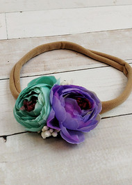 "Aqua and lavender floral embellished large nylon hair tie or ponytail holder for girls. Fits best as a headband if you stretch the band before wearing. 9"" un-stretched, approximately 14"" stretched."