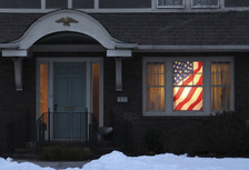 Old Glory USA American Flag Decorative Window Poster as seen in a house at night illuminated with interior lights.